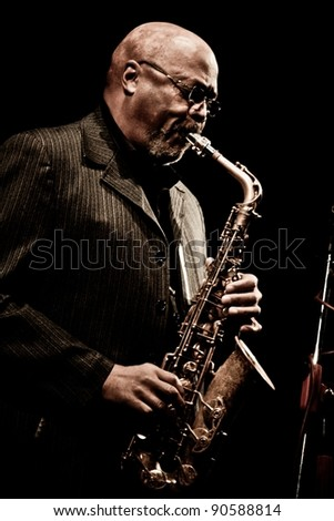 "TERNOPIL, UKRAINE - DECEMBER 10: Band ""Tarbaby"" Oliver Lake alt sax (founder of the «World Saxophone Quartet») perform as part of annual  Festival ""Jazz Bez"" on December 10, 2011 in Ternopil, Ukraine"