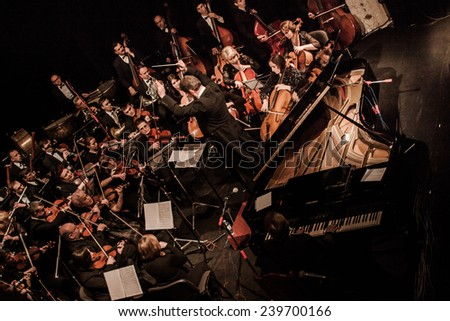 "TERNOPIL, UKRAINE - DECEMBER 12: Ternopil Philharmonic Symphony Orchestra  as part of annual Festival ""Jazz Bez"" on December 12, 2014 in Ternopil, Ukraine - stock photo"