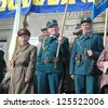 TERNOPIL , UKRAINE - OCTOBER 17: Unidentified veterans hold various flags during military parade Ukrainian Liberation Army, October 17, 2005 in Ternopol, Ukraine - stock photo