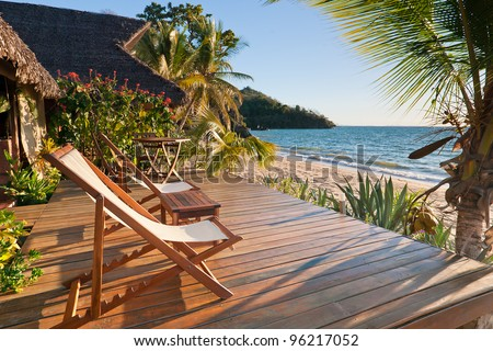 Terrace at sunset on a tropical beach - stock photo