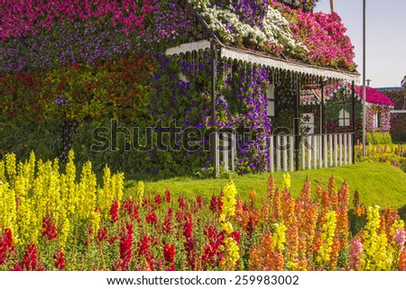 terrace house of flowers and colorful lawn in the Miracle Garden - stock photo