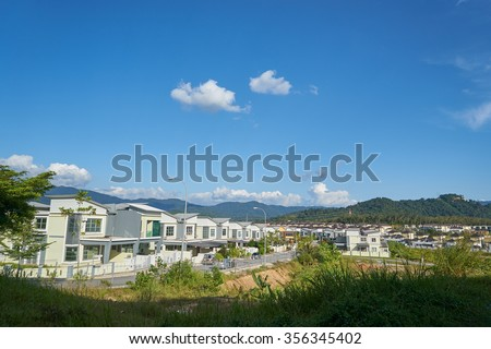 terrace house under the blue skies - stock photo