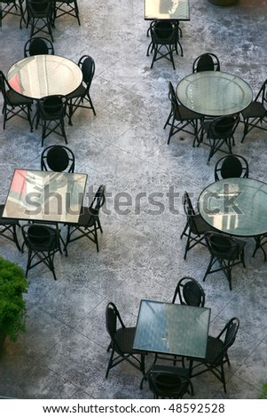 terrace of an european bar tables and chairs - stock photo