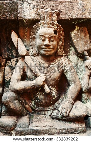 Terrace of the Leper King, Angkor Wat, Cambodia. Close up detail of the wall statue