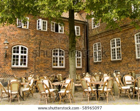 Terrace on the street of an European city - stock photo