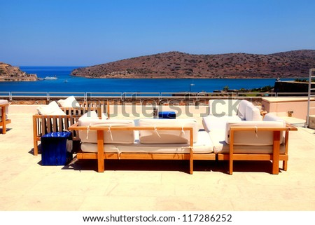 Terrace seaview with lounge sofa and armchair in a luxury resort(Crete, Greece) - stock photo