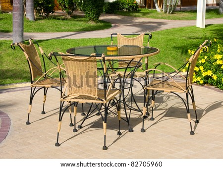 Terrace with table and chairs in garden - stock photo
