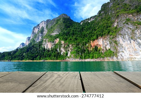 terrace wood and Jetty walkway into the sea for background usage - stock photo
