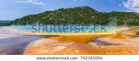 Terraces fan out from vivid colors of the Grand Prismatic Spring in Yellowstone National Park, Wyoming.