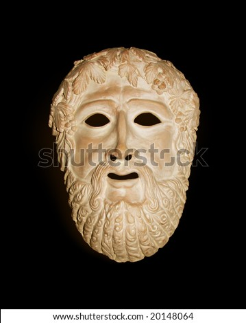 terracotta ancient Greek theater mask isolate on the black - stock photo