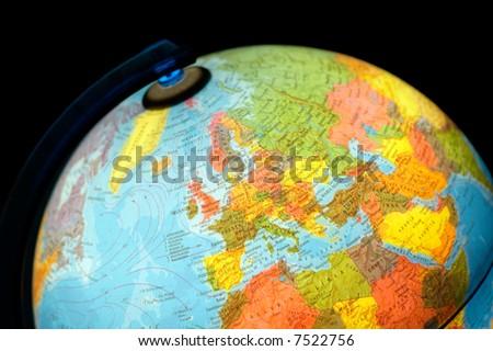 terrestrial globe on black background - stock photo