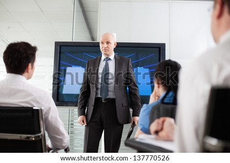 Terrible boss giving his employees a hard time - stock photo