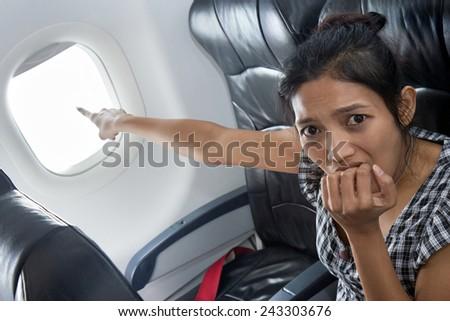 terrified passenger on a plane - stock photo