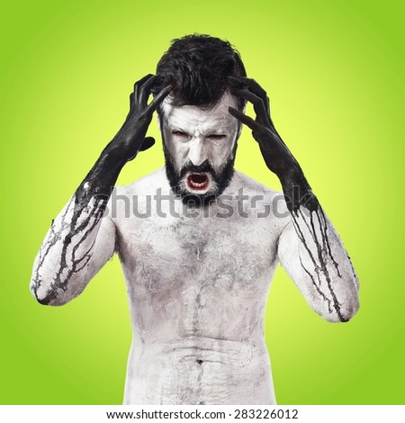 Terrifying Vampire over colorful background - stock photo