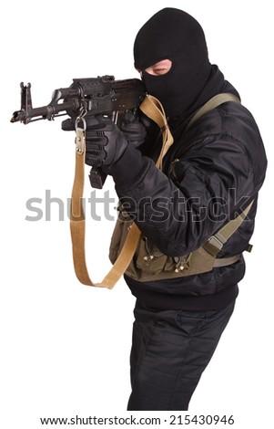 terrorist in black uniform and mask with kalashnikov isolated - stock photo