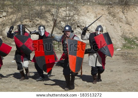 TERUEL, SPAIN - FEBRUARY 22 2014: Participants during the representation of a medieval battle taking place within the party The Marriage of Isabel de Segura in Teruel every month in February. - stock photo