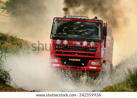 TERUEL, SPAIN - JUL 19 : Dutch driver Ton Van Gerugten and his codrivers Anton Van Limpt and Eric Van Gemert in a DAF TE85XC race in the XXXI Baja Spain, on Jul 19, 2014 in Teruel, Spain. - stock photo