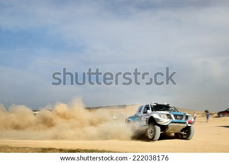 TERUEL, SPAIN - JUL 19 : Portuguese driver Paulo Ferreira and his codriver Jorge Monteiro in a Nissan Navara race in the XXXI Baja Spain, on Jul 19, 2014 in Teruel, Spain. - stock photo