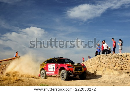 TERUEL, SPAIN - JUL 19 : Qatari driver Nasser Al-Attiyah and his codriver Matthieu Baumel in a HRX Ford race in the XXXI Baja Spain, on Jul 19, 2014 in Teruel, Spain. - stock photo