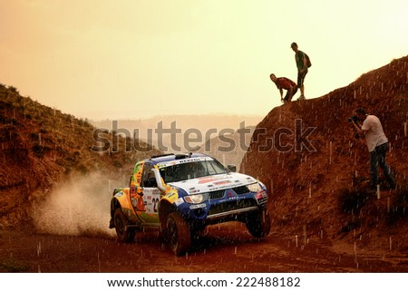 TERUEL, SPAIN - JUL 19 : Spanish driver Josep Maria Servia and his codriver Fina Roman in a Mitsubishi L200 race in the XXXI Baja Spain, on Jul 19, 2014 in Teruel, Spain. - stock photo