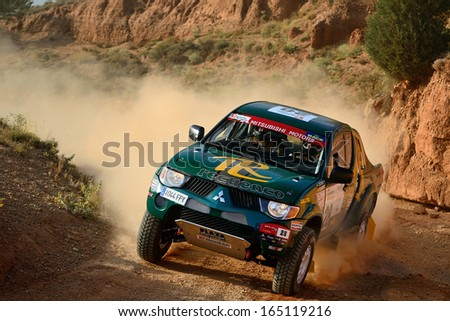 TERUEL, SPAIN - JUL 7 : Spanish driver Luis Recuenco and his codriver Victor Alijas in a Mitsubishi L200 race in the XXX Baja Spain, on Jul 7, 2013 in Teruel, Spain. - stock photo