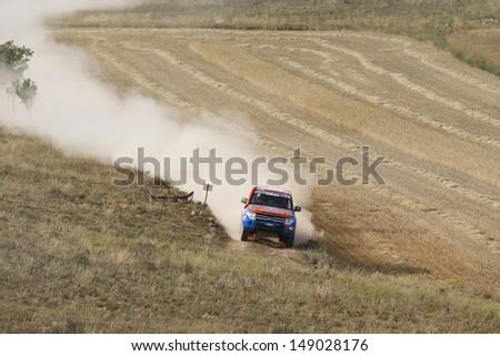 TERUEL, SPAIN - JULY 20. Brazilian driver Marco Erminio Moraes and  co driver Carlos Eduardo Prates in a Mitsubishi Pajero, race in Baja Spain, on Jul 20, 2013 in Teruel, Spain. - stock photo