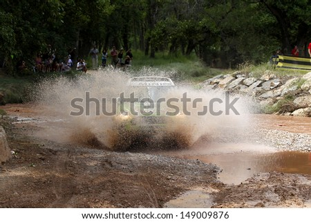 TERUEL, SPAIN - JULY 21 :French driver St���©phane Peterhansel and  co driver Jean Paul Cottret in a MINI ALL4 Racing, race in Baja Spain, on Jul 21, 2013 in Teruel, Spain. - stock photo