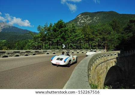 TESIMO (BZ) ITALY - AUGUST 31: White Porsche 550 spider, built in 1955, takes part to the Coppa d'Oro delle Dolomiti historic car race, on August 31, 2013 in Tesimo (BZ), Italy. - stock photo