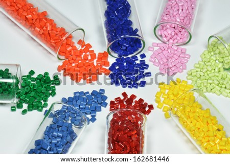 test glasses with dyed polymer resins on white - stock photo