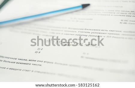 test job with the formula on a sheet of paper with a pen - stock photo