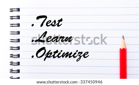 Test Learn Optimize written on notebook page, red pencil on the right. Motivational Concept image