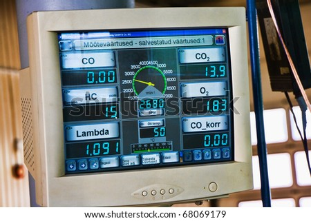 Test results on a computer screen from a vehicle emissions testing machine - stock photo