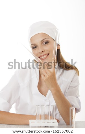 Test tube with blood sample and doctor, isolated - stock photo