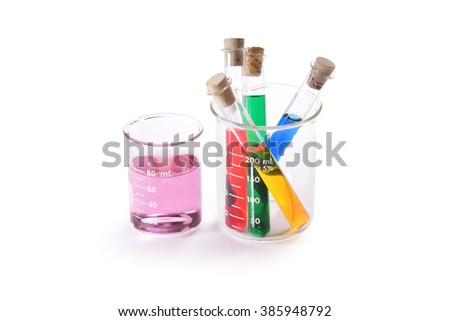 Test tubes and beakers with colorful liquids isolated on white - stock photo