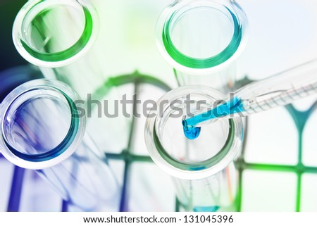 Test tubes close-up on color background. - stock photo