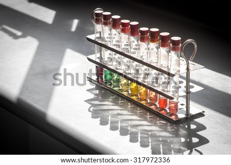 Test tubes containing chemical with different colour