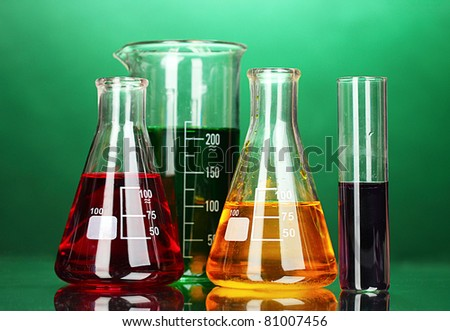 test tubes in a laboratory on a green background