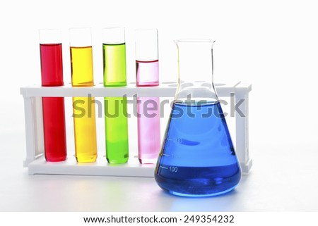 test tubes in a test on white background for symbolic photo for learning and researching. - stock photo