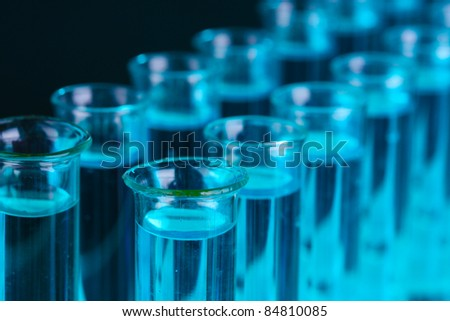 Test-tubes on blue background - stock photo