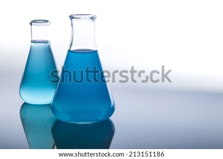 Test-tubes with blue liquid in a laboratory - stock photo