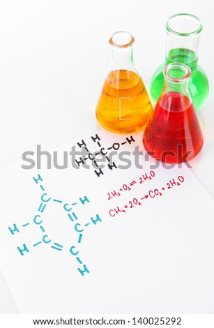 Test tubes with colorful liquids and formulas isolated on white - stock photo