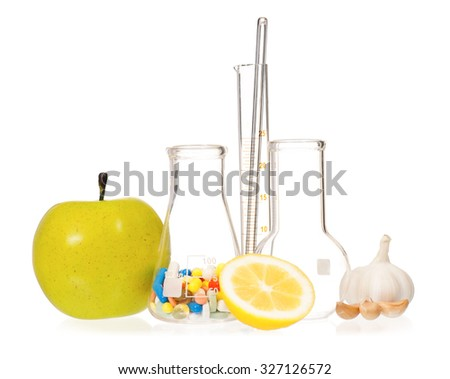 Test tubes with colorful pills, slice lemon and garlic, isolated on white background