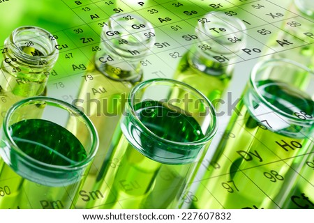 Test tubes, with periodic table, in laboratory - stock photo