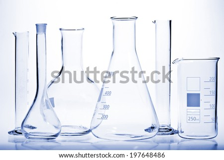 Test-tubes with reflections on a white and blue background. Laboratory glassware.
