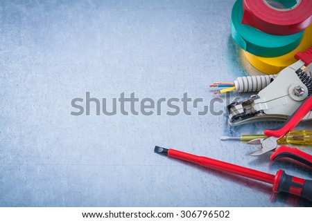 Tester screwdriver electricians tape corrugated wire protection nippers strippers copyspace. - stock photo