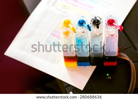 Testing a CMYK ink printer cartridge - stock photo