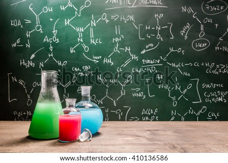 Testing new chemical reactions in school laboratory - stock photo