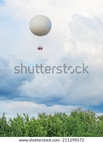 Tethered aerostat balloon. Place for text. - stock photo