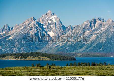 Teton range and Jackson Lake panoramic at Grand Teton National Park near Jackson, Wyoming - stock photo