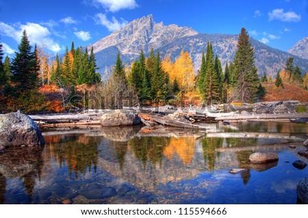 Teton Range Reflection on Jenny Lake, Wyoming, America - stock photo
